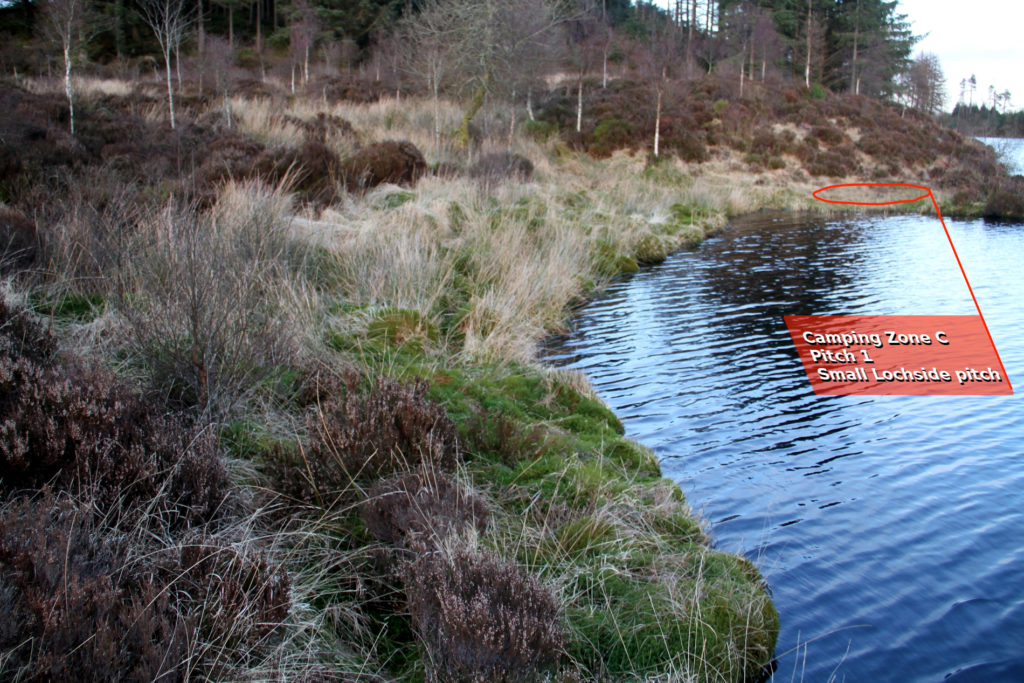 A small loch side area on a gentle slope, has been enlarged by cutting back heather to accomodate small tent with hazards.